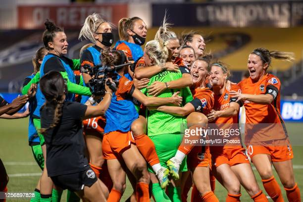 Houston Dash celebrate with goalkeeper Jane Cambell after winning a game between Utah Royals FC and Houston Dash at Zions Bank Stadium on July 17,...