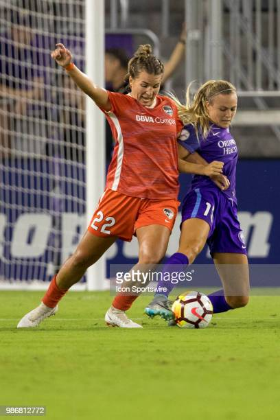 Houston Dash defender Amber Brooks and Orlando Pride forward Rachel Hill go for the ball during the soccer match between the Orlando Pride and the...