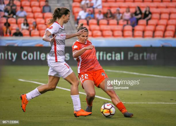 Houston Dash defender Amber Brooks attempts to intercept the ball dribbled by Portland Thorns FC midfielder Tobin Heath during the soccer match...