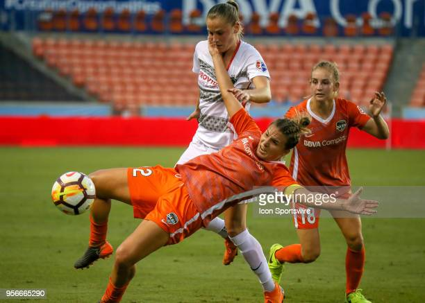 Houston Dash defender Amber Brooks leaps to trap the ball during the soccer match between the Portland Thorns and Houston Dash on May 9 2018 at BBVA...