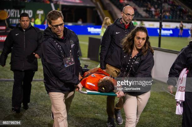 Houston Dash defender Bruna Benites has to leave the field in a stretcher after sufering an injury during the preseason match between the Portland...