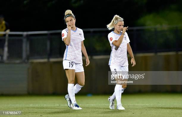 Houston Dash defender Kristie Mewis and forward Rachel Daly make a hand gesture to complete their handshake during the National Womens Soccer League...