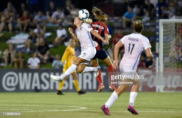 Houston Dash forward Rachel Daly heads a ball as Washington Spirit defender Amy Harrison defends during the National Womens Soccer League game...