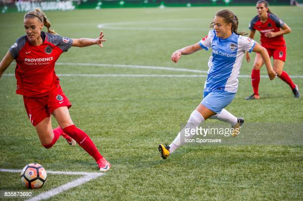 Houston Dash midfielder Andressinha attemps to control a long pass marked by Portland Thorns midfielder Dagny Brynjarsdottir during the first half of...