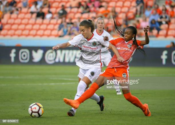 Houston Dash midfielder Linda Motlhalo challenges Portland Thorns FC midfielder Andressinha for the ball during the soccer match between the Portland...