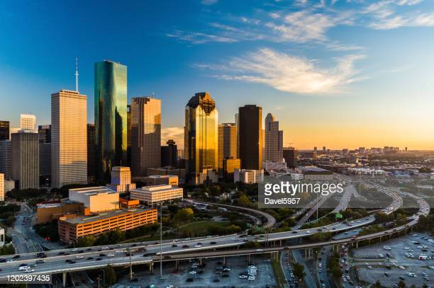 houston downtown aerial at sunset, angled view with highway - texas stock pictures, royalty-free photos & images