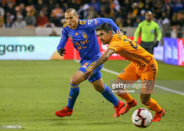 Houston Dynamo defender A J DeLaGarza keeps the ball away from UANL Tigres defender Jorge Torres during the CONCACAF Champions League Quarterfinal...