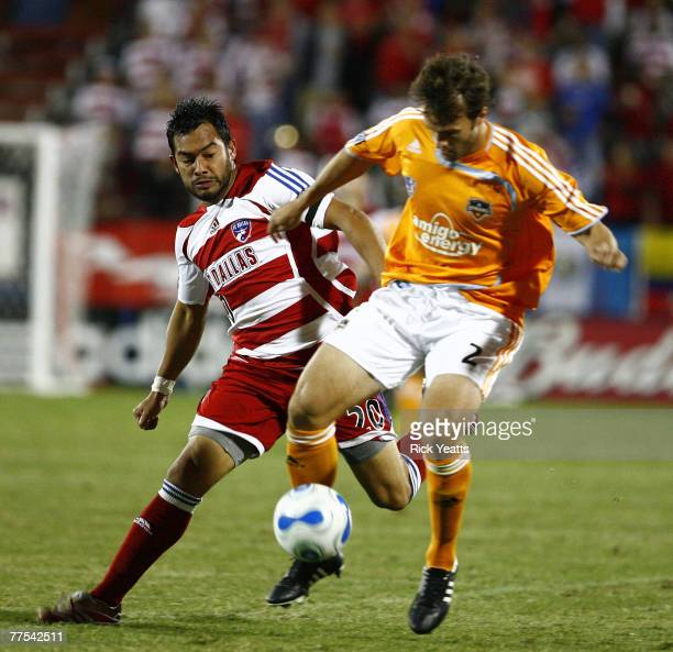 Houston Dynamo defender Eddie Robinson steals the ball from FC Dallas forward Carlos Ruiz during the first game of the Western Conference semifinal...