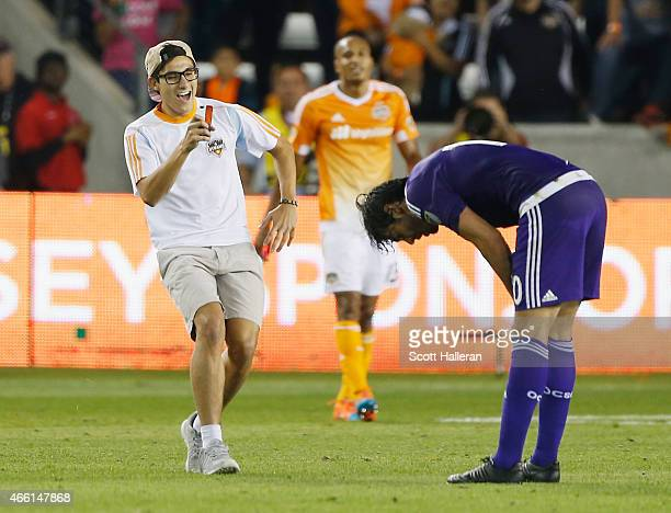 Houston Dynamo fan snaps a photo on the field of Kaka of the Orlando City SC during their game against the Houston Dynamo during their game at BBVA...