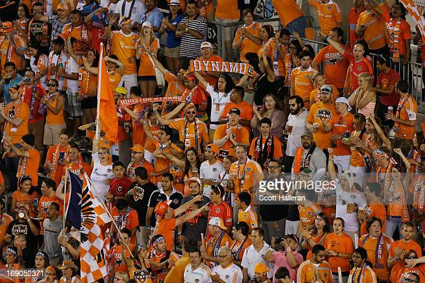 Houston Dynamo fans watch the play against Sporting Kansas City in the second half at BBVA Compass Stadium on May 12 2013 in Houston Texas