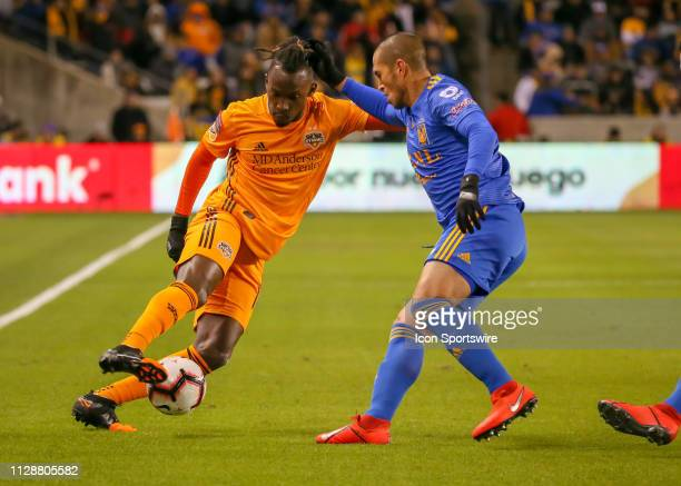 Houston Dynamo forward Alberth Elis keep the ball away from UANL Tigres defender Jorge Torres during the CONCACAF Champions League Quarterfinal match...