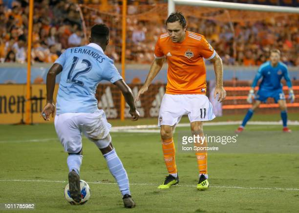 Houston Dynamo forward Andrew Wenger approaches to challenge Sporting Kansas City forward Gerso during the soccer match between Sporting Kansas City...