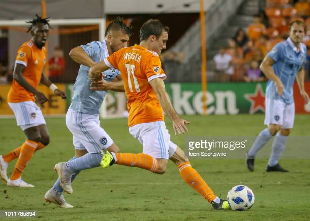 Houston Dynamo forward Andrew Wenger keeps the ball away from Sporting Kansas City forward Diego Rubio during the soccer match between Sporting...