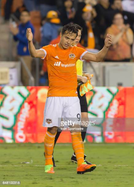 Houston Dynamo forward Erick Torres celebrates after his team won 21 during the MLS opening match between the Seattle Sounders and Houston Dynamo on...