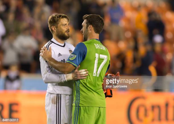 Houston Dynamo goalkeeper Tyler Deric and Seattle Sounders defender Will Bruin greet each other at the end of the MLS opening match between the...
