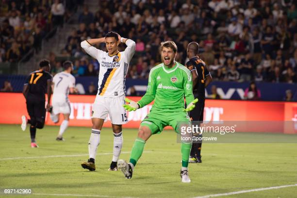 Houston Dynamo goalkeeper Tyler Deric reacts after Los Angeles Galaxy forward Ariel Lassiter misses a shot on goal during the game between the LA...