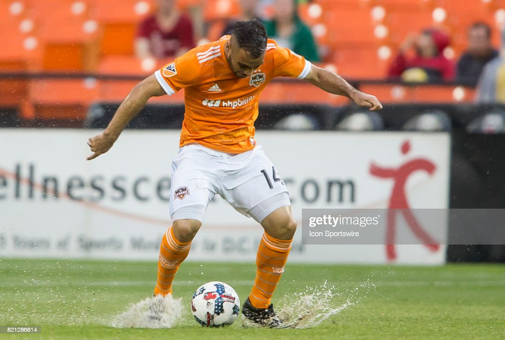 Houston Dynamo midfielder Alex (14) controls the ball on a waterlogged pitch during a MLS match between DC United and the Houston Dynamo on July 22, 2017, at RFK Stadium, in Washington DC. The Dynamo defeated DC United 3-1.