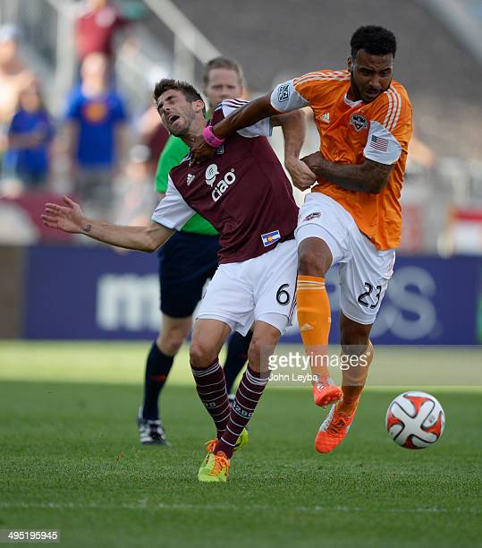 Houston Dynamo midfielder Giles Barnes gives a shove to Colorado Rapids midfielder Jose Mari as he goes after the ball during the first half June 1...