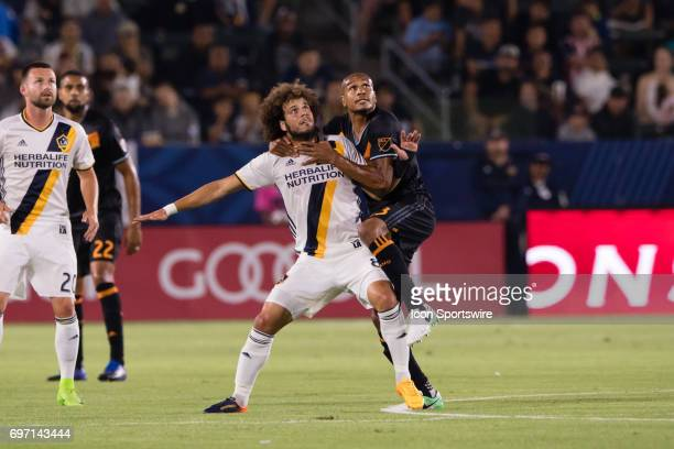 Houston Dynamo midfielder Ricardo Clark climbs onto Los Angeles Galaxy midfielder Joao Pedro to defend during the game between the LA Galaxy and the...