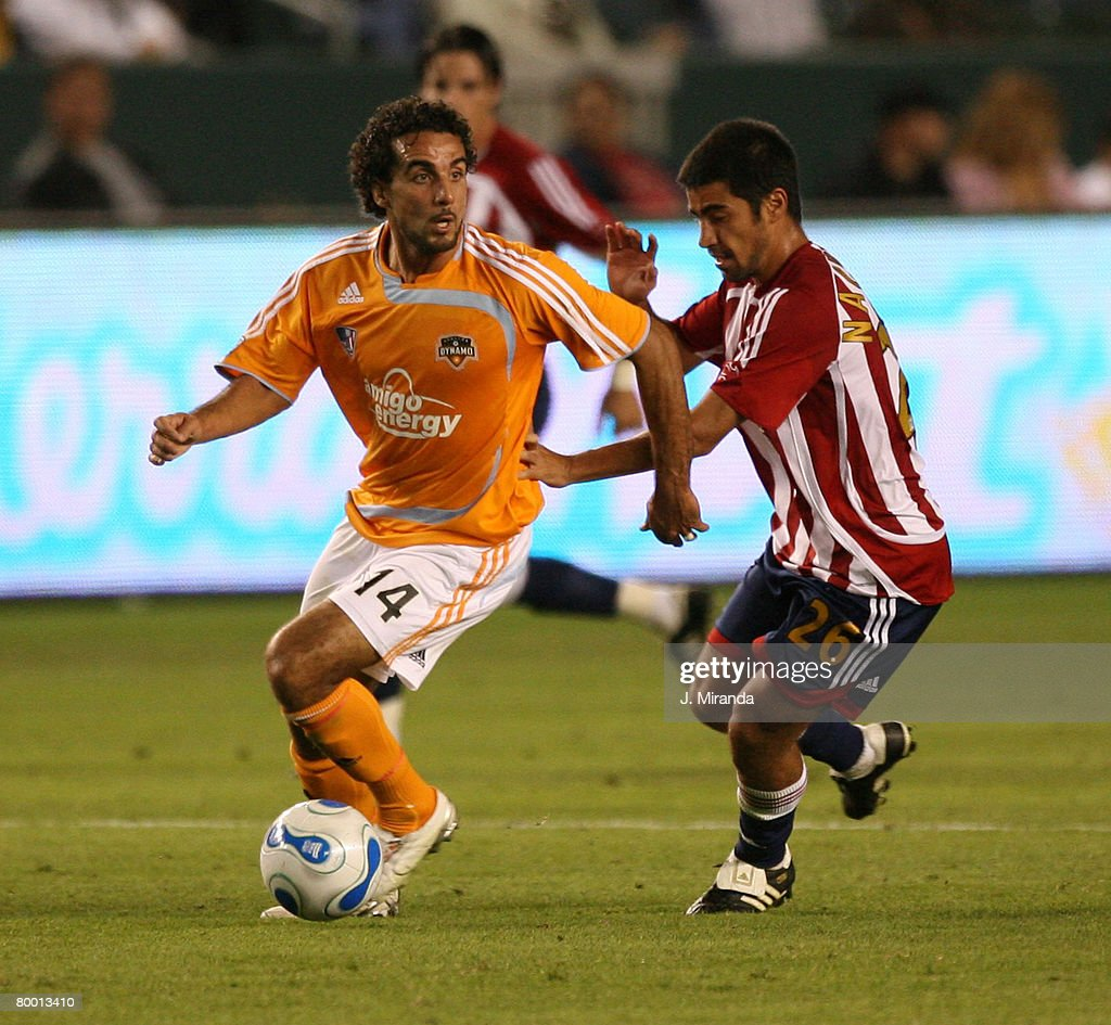 Houston Dynamo's Dwayne De Rosario in action against Chivas USA's Paulo Nagamura. Chivas takes the regular season Western Conference title following a scoreless draw with Dynamo at The Home Depot Center on October 20, 2007 in Carson.