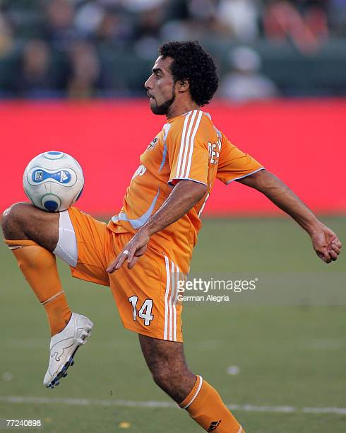 Houston Dynamo's Dwayne De Rosario in action against the Los Angeles Galaxy defensive line during today's match at the Home Depot Center, Carson, CA....