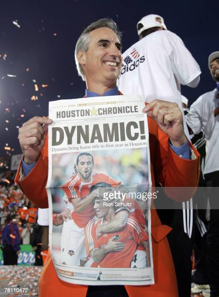 Houston Dynamo's President and General Manager Oliver Luck holds the first page of the Houston Chronicle after Houston defeated the New England...
