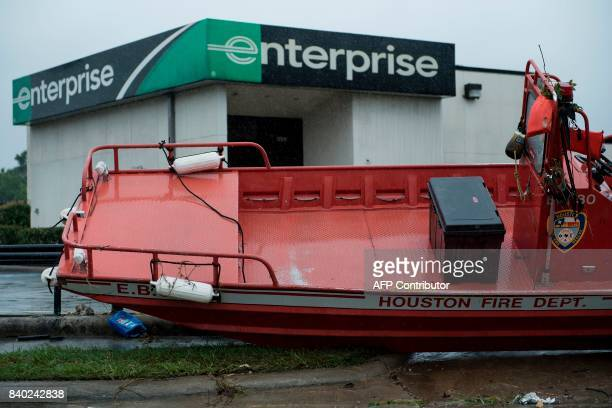A Houston fire department rescue boat is seen stranded near a car rental shop during the aftermath of Hurricane Harvey on August 28 2017 in Houston...