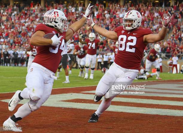Houston Heimuli and Kaden Smith of the Stanford Cardinal celebrates after Heimuli caught a one yard touchdown pass against the Washington State...