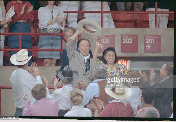 Japanese Prime Minister Toshiki Kaifu and wife Sachiyo wave to the crowd as they are introduced upon arrival at a Houston rodeo 7/8