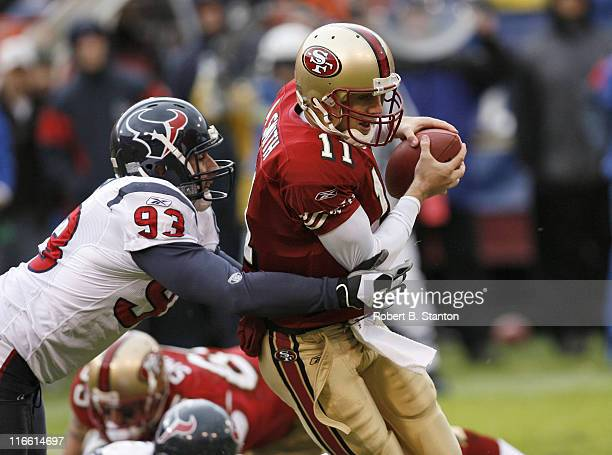 Houston linebacker Jason Babin gets to 49ers rookie quarterback Alex Smith in the first half as the San Francisco 49ers defeated the Houston Texans...