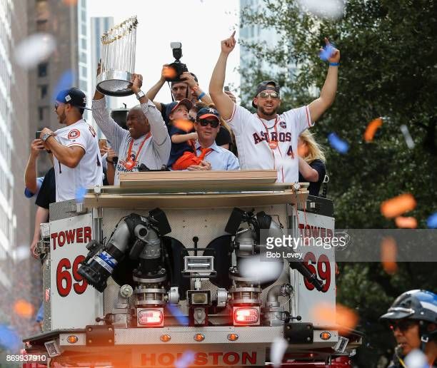 Houston Mayor Sylvestor Turner lifts up the Championship Trophy as Carlos Correa Astros owner Jim Crane and George Springer during the Houston Astros...
