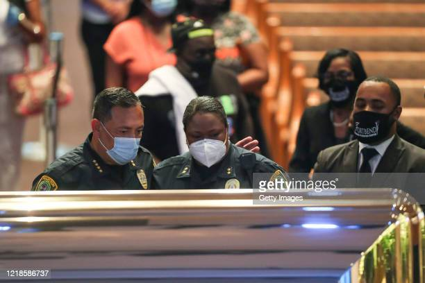 Houston Police Chief Art Acevedo and Assistant Chief Sheryl Victorian view the remains of George Floyd during a public visitation at the Fountain of...