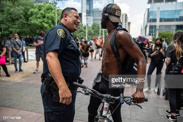 Houston Police Chief Art Acevedo greets a man as before a march in honor of George Floyd on June 2, 2020 in Houston, Texas. Members of George Floyd's...