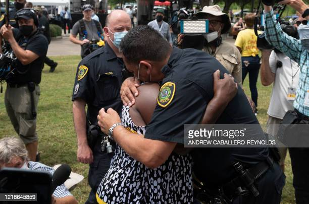 Houston Police Chief Art Acevedo hugs a woman while people wait in line to attend the public viewing for George Floyd at the Fountain of Praise...