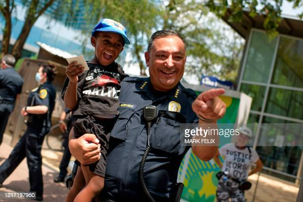 Houston police chief Art Acevedo talks with members of the community gathered to mourn the death of George Floyd during a march across downtown...