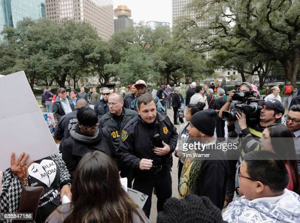 Houston Police Chief Art Acevedo talks with protesters who gather at City Hall prior to the march to Minute Maid Park to protest President Donald...