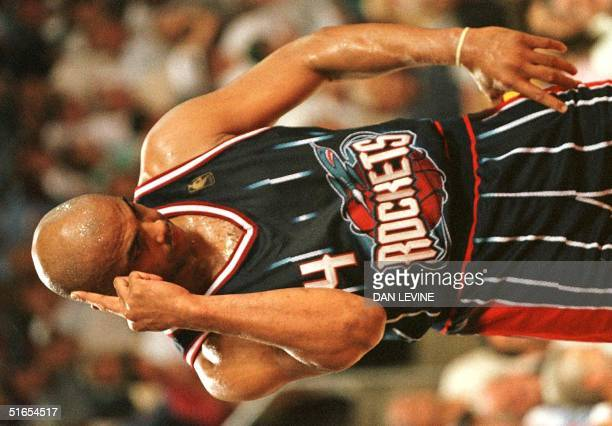 Houston Rockets' Charles Barkley makes an obscene gesture to the crowd 15 May during game six of their Western Conference semifinal against the...
