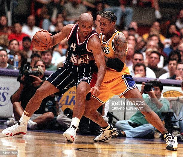Houston Rockets Charles Barkley pushes his way to the basket against Los Angeles Lakers Dennis Rodman at the Great Western Forum in Inglewood CA 28...
