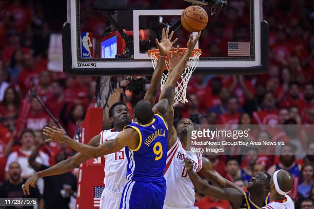 Houston Rockets' Clint Capela and Houston Rockets' Terrence Jones guard against Golden State Warriors' Andre Iguodala in the third quarter of Game 4...