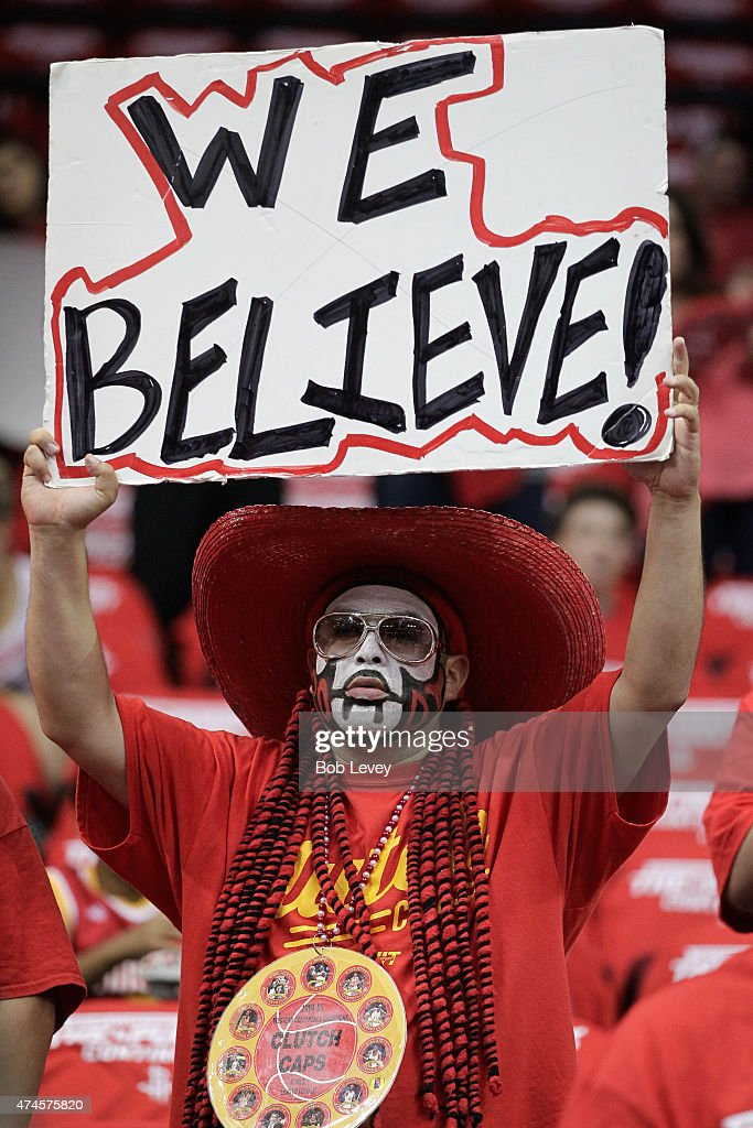 Houston Rockets fans cheer during Game Three of the Western Conference Finals at Toyota Center on May 23, 2015 in Houston, Texas.
