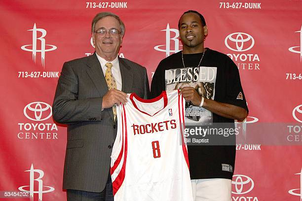Houston Rockets General Manager Carroll Dawson and Derek Anderson hold up Anderson's new jersey after signing a free agent contract with the Rockets...