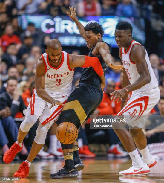 Houston Rockets guard Chris Paul hooks Toronto Raptors guard Kyle Lowry with his arm as Lowry defends Toronto Raptors vs Houston Rockets in 1st half...