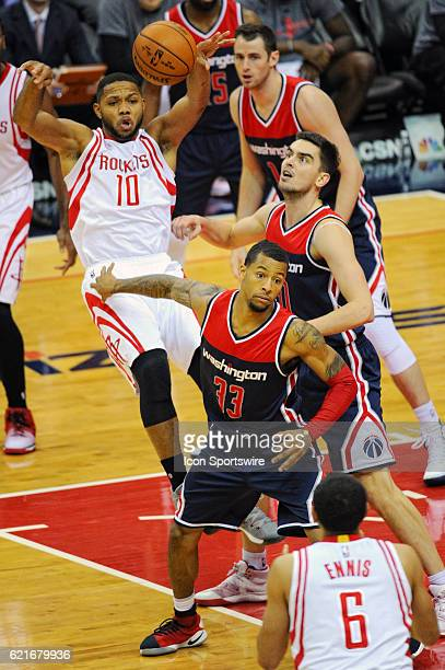 Houston Rockets guard Eric Gordon makes a pass to guard Tyler Ennis against Washington Wizards guard Trey Burke on November 7 at the Verizon Center...