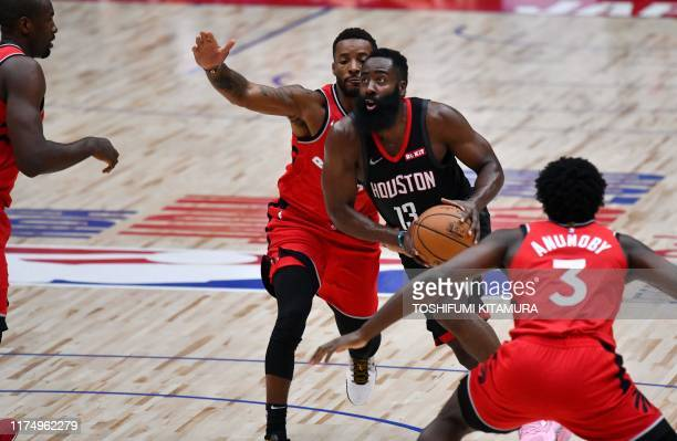 Houston Rockets guard James Harden drives past Toronto players during the National Basketball Association Japan Games 2019 pre-season basketball...