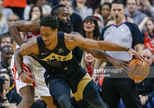 d829115579b Houston Rockets guard James Harden knocks the ball as Toronto Raptors guard  DeMar DeRozan tries to