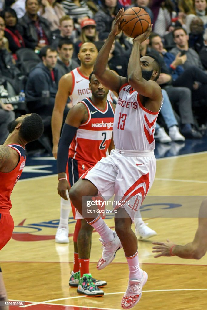 Houston Rockets guard James Harden (13) scores against the Washington Wizards on December 29, 2017 at the Capital One Arena in Washington, D.C. The Washington Wizards defeated the Houston Rockets, 121-103.