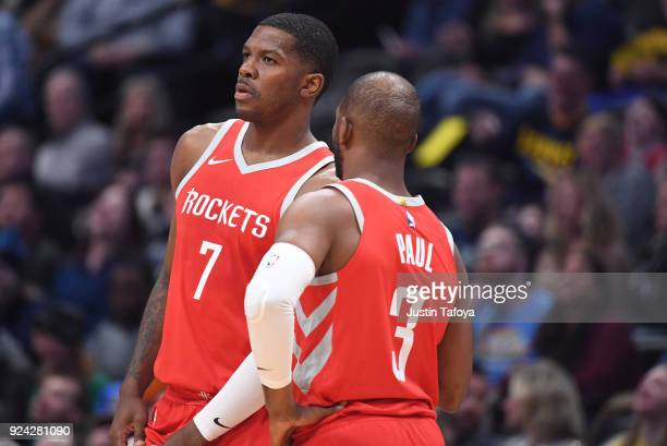 Houston Rockets guard Joe Johnson talks with Houston Rockets guard Chris Paul during a timeout during the game against the Denver Nuggets at Pepsi...