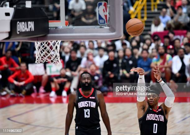 Houston Rockets guard Russell Westbrook shoots a free throw as teammate James Harden looks on during the National Basketball Association Japan Games...