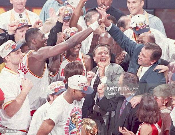 Houston Rockets' Hakeem Olajuwon gets a high five from head coach Rudy Tomjanovich during the trophy presentation14 June after their teams 113101...