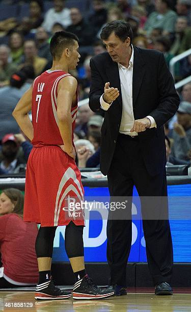 Houston Rockets head coach Kevin McHale talks with Houston Rockets point guard Jeremy Lin during a timeout in the first half of their game against...